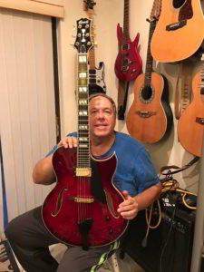 Jerry Bloch holding is new Equity Series Heirloom Conti Archtop Guitar in Ruby Red Finish