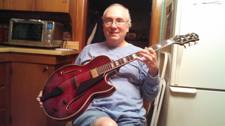 John McCarty with his Conti Heirloom Archtop Guitar