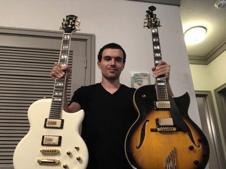 Joseph Ahmad standing proud with a Conti Solid Body and a Conti Heirloom archtop