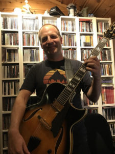 Skjalg holding his Conti Heirloom Archtop