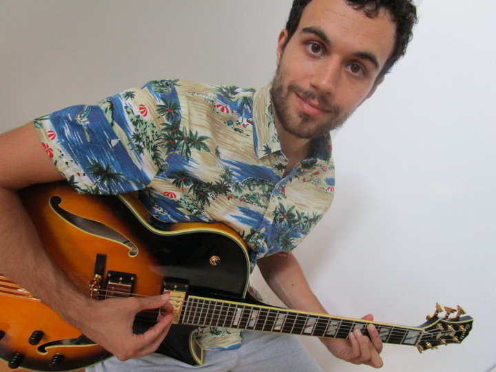 Joseph Ahmad with his double pickup Conti Heirloom Archtop Jazz Guitar