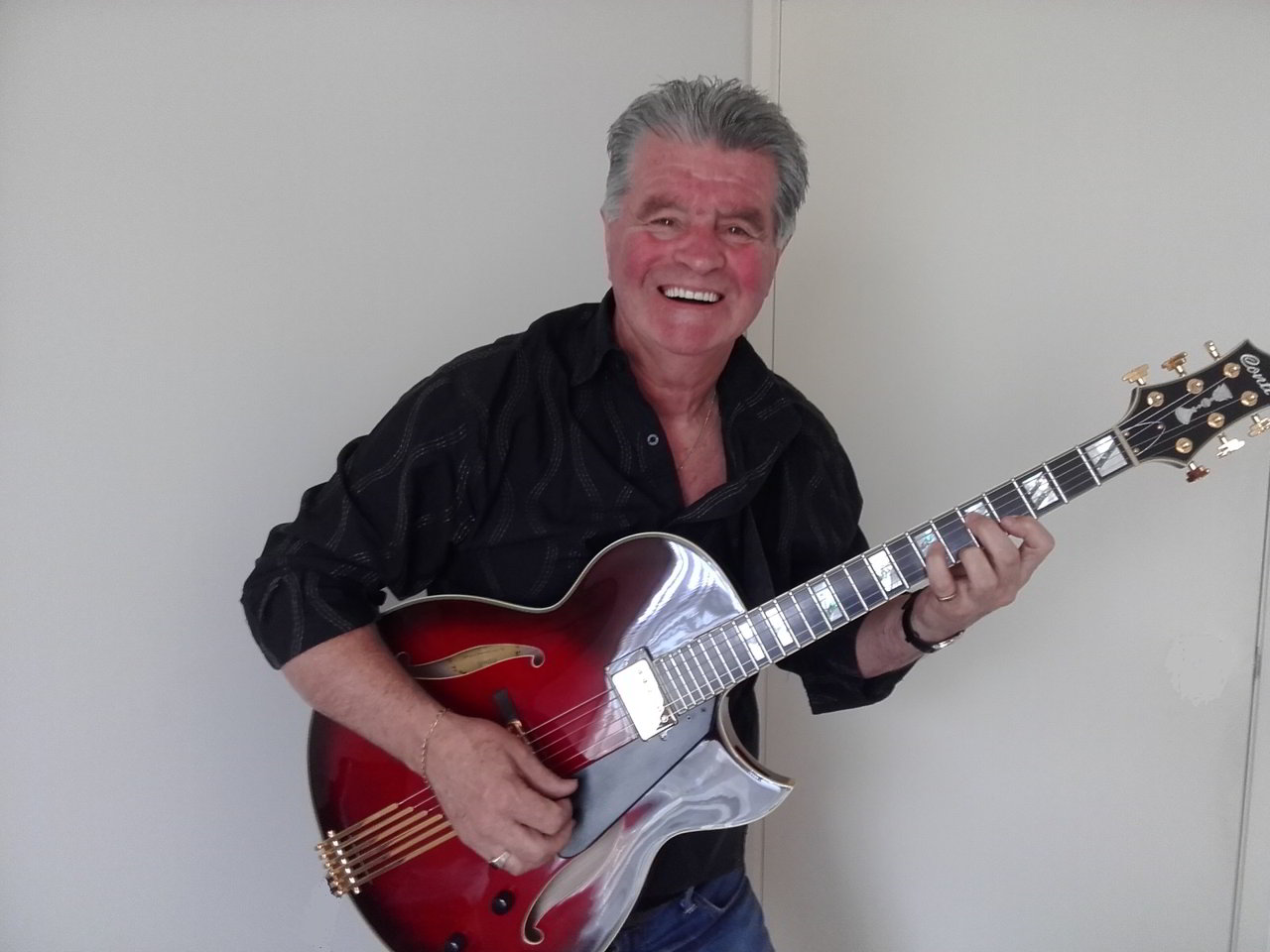 Mike Powell with his Ruby Red Conti Heirloom Archtop Guitar