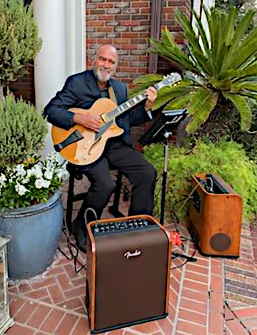 Wayne Holt on the gig with his Conti Equity archtop